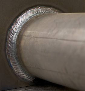 large stainless steel pipe with weldings around top